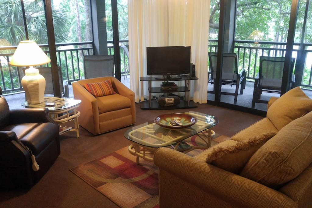 Family room with direct access to screened lanai on 2 sides.