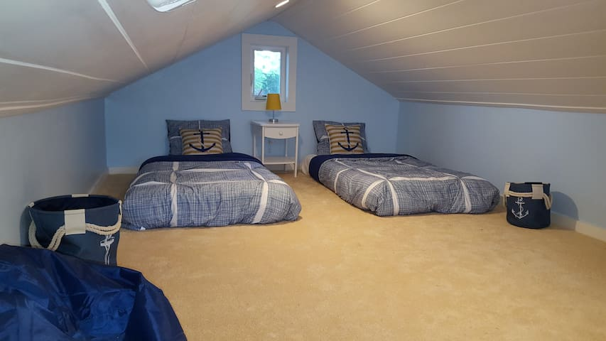 Loft area with 2 poster pedic memory foam beds and plush carpet. There are also 2 bean bag chairs. Great space very roomy, lower head room on the sides. ONLY ACCESSIBLE BY A LADDER.