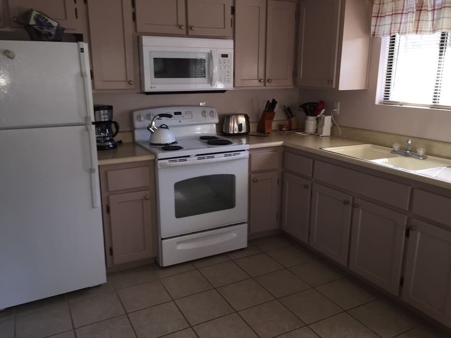 Kitchen has microwave, coffee maker, pots, pans and dishes. Regular and decaf coffee provided along with tea bags.