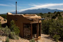 We have exceptional mountain views from the property, with unique features visible in every direction.  The Kiva is nestled in to its own little hillside.