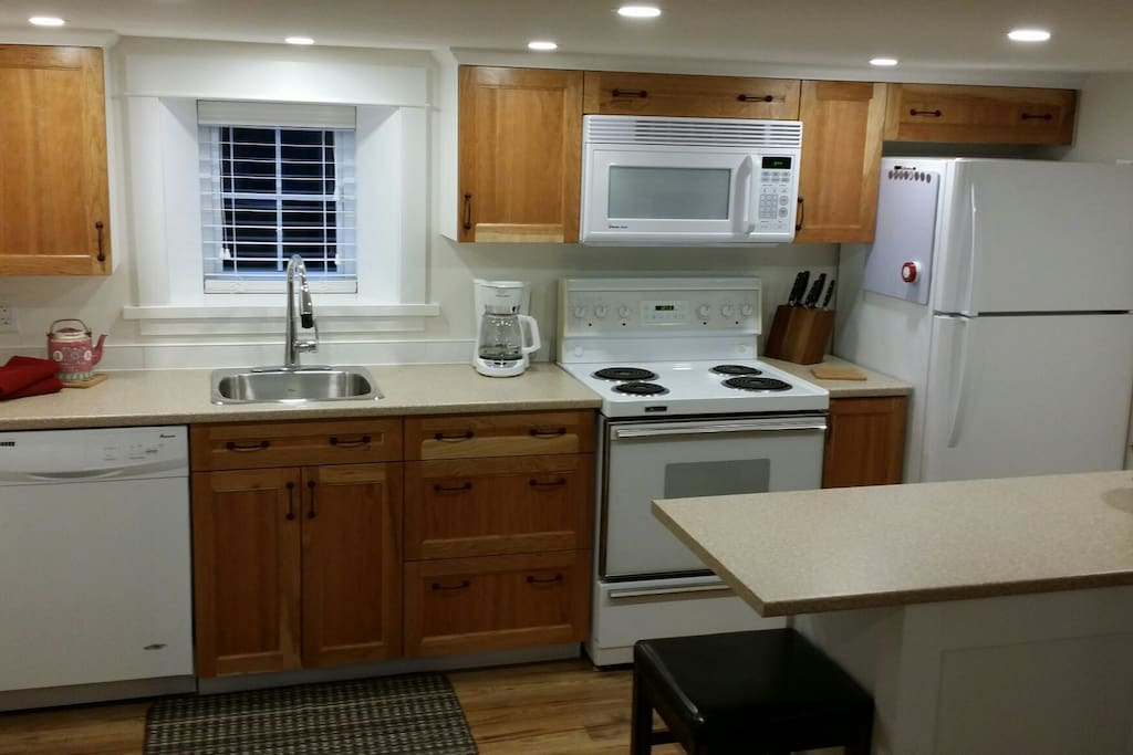 A brand new kitchen with new appliances makes it even better than home.
