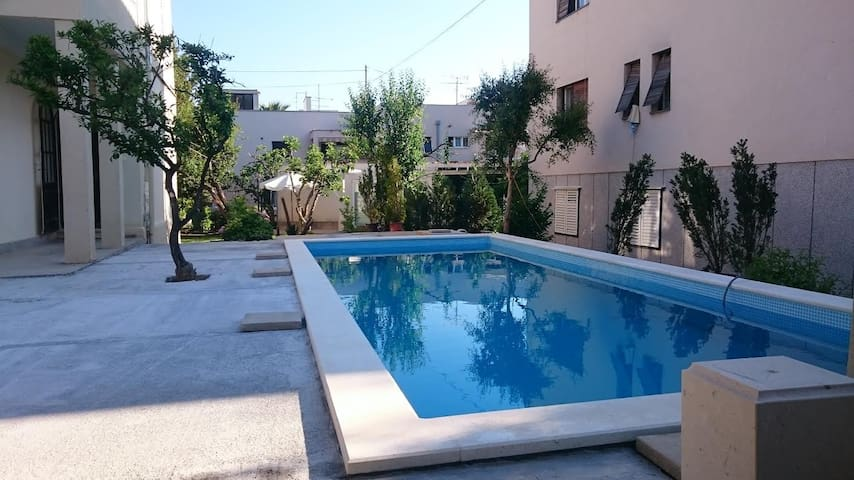 GREEN APARTMENT WITH HEATED OUTDOOR POOL & JACUZZI