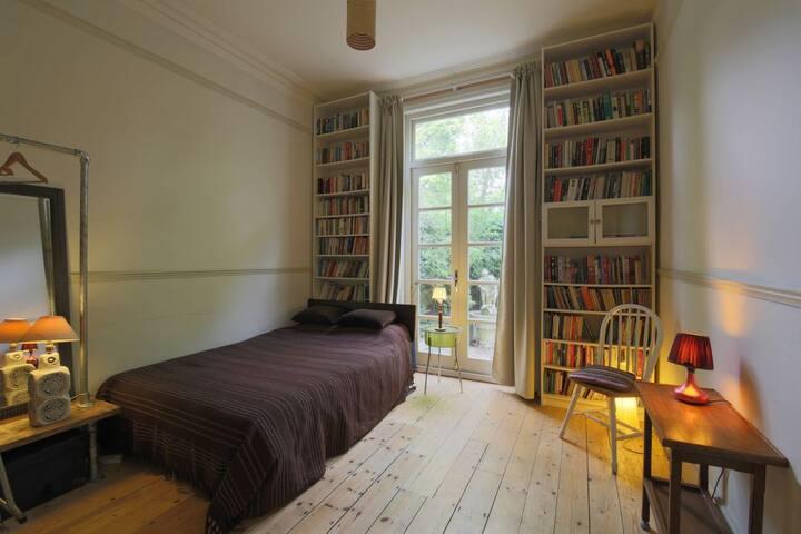 Bedroom 2: Downstairs double bedroom with doors onto terrace.