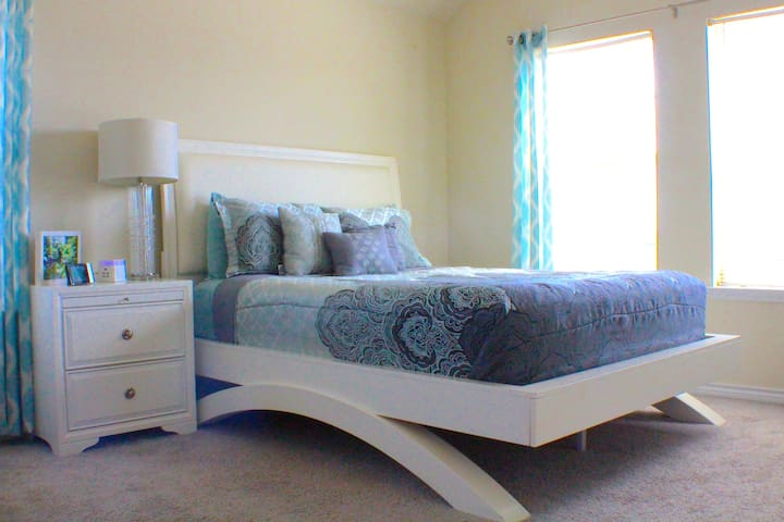 Queen size bed with walk-in closet