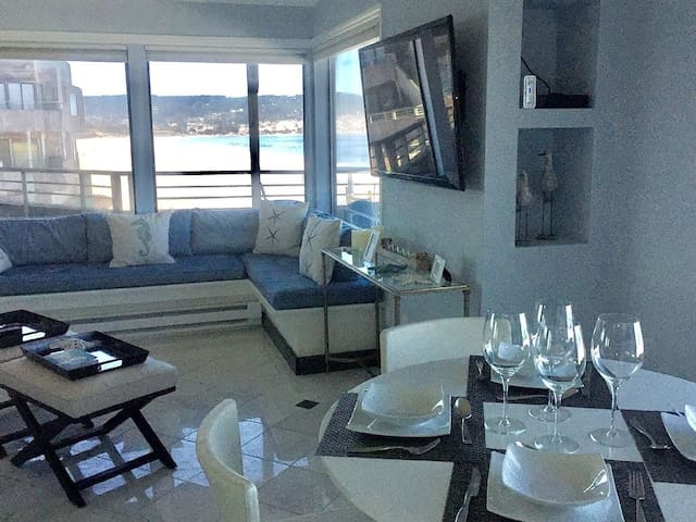 Open and comfortable design in this beautifully decorated one bedroom condominium.  Yes, on the left, that's a view of the famous condo from the HBO hit Big Little Lies!