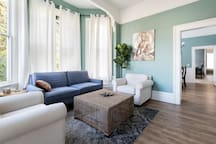 Living Room: Large windows let in great natural light. Relax and binge your favorite shows from the SmartTv.