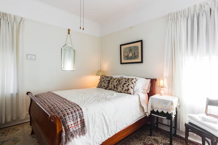 This is the full size bed in your room.  An air conditioner and ceiling fan will keep you comfortable on warm nights