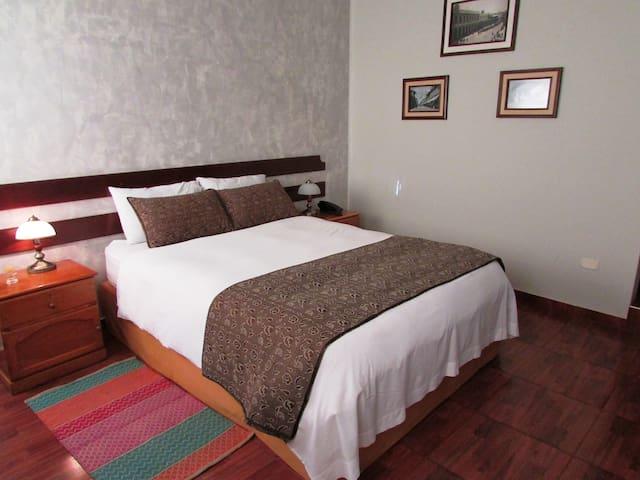 Comfortable room at Queens Villa Hotel Boutique
