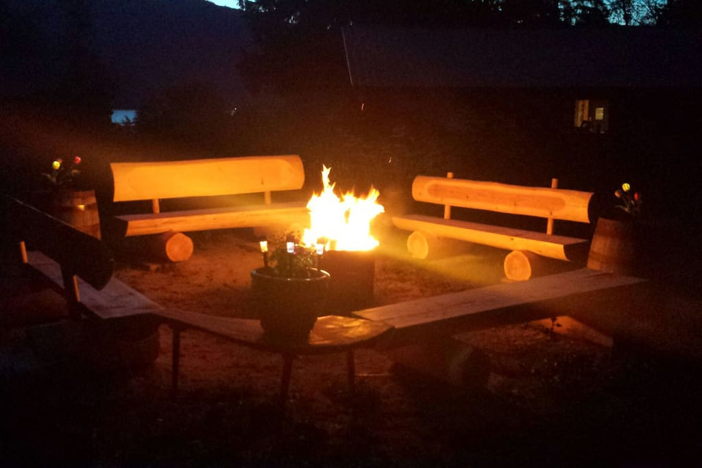 Private Fire Pit with 4 Custom Log Benches and Solar Lighting. This fire pit #2 is located in the back yard.