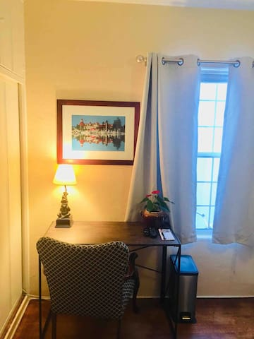 Business nook with easy access to electric outlet perfect for charging notebooks and laptops.