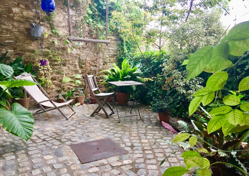 patio...coziness and charm to enjoy your holiday book surrounded by loved plants