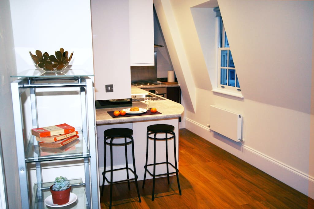 Enjoy a snack at our breakfast bar, in our super top floor studio flat