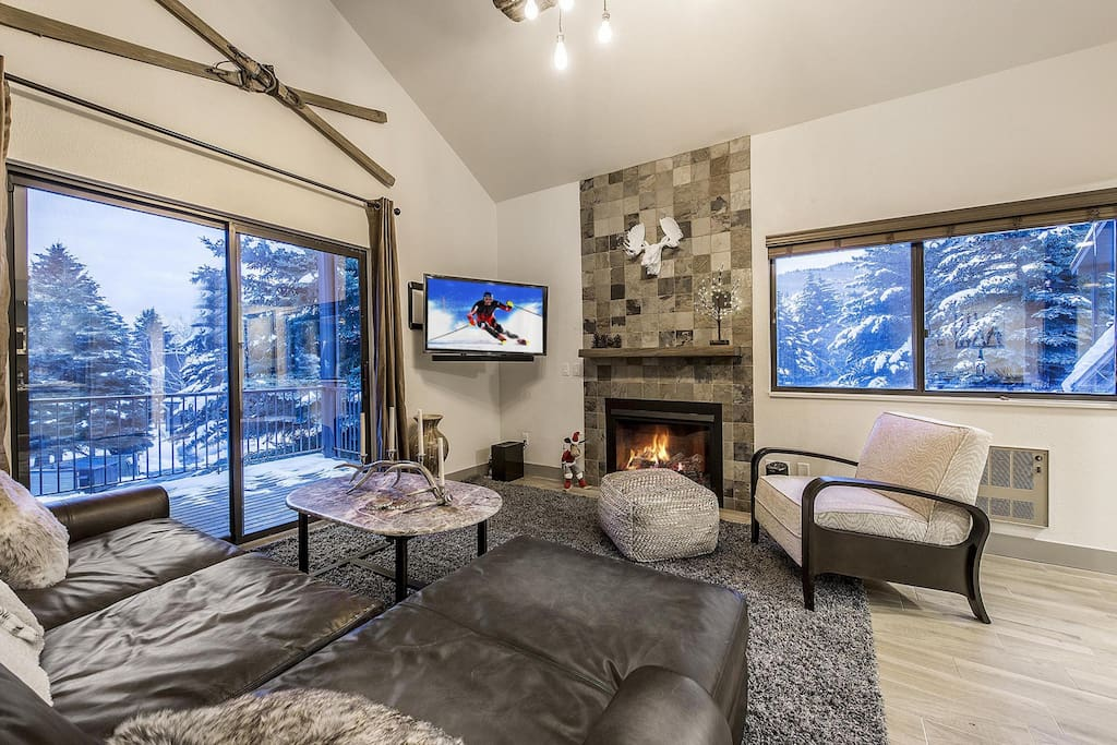 Completely remodeled unit with gas fireplace and huge plasma screen TV