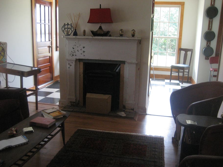 Gas fireplace with dining area behind it.