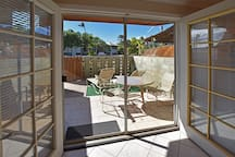 French doors lead out from the living room onto the private lanai patio.