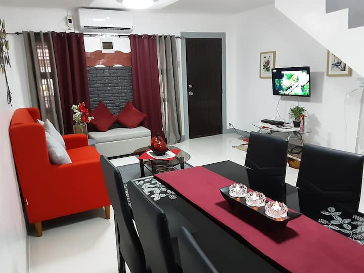 Haxon Leigh's Red and Grey Themed Staycation House