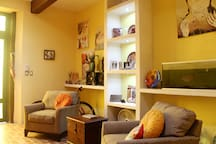 """Living room art. """"The house is truly an urban oasis and art gallery in one."""" --Avra"""