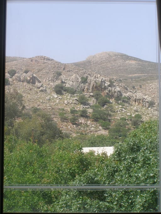The beautiful mountain view from the bedroom window.