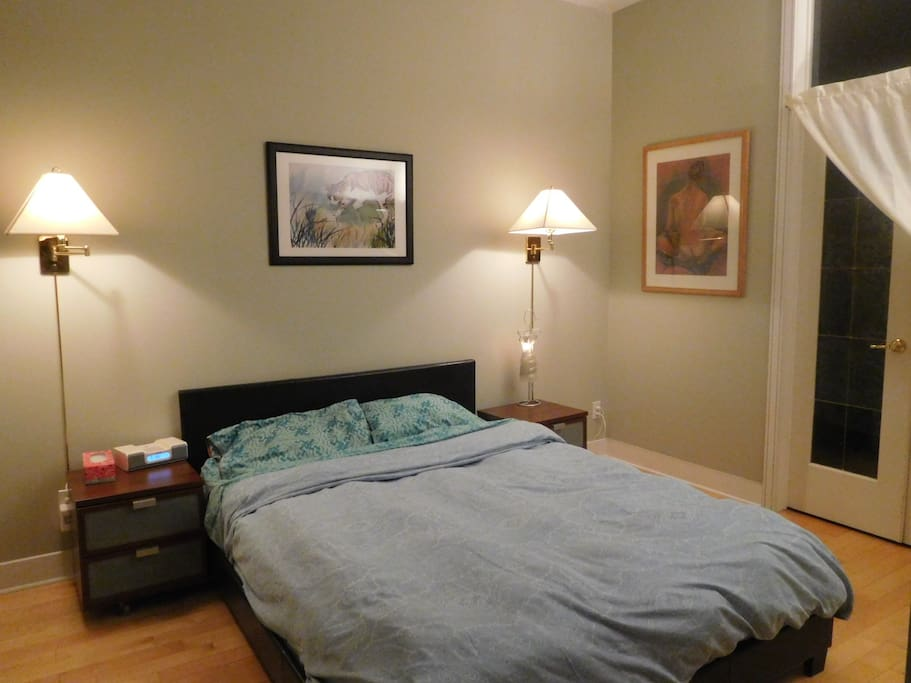 A comfortable queen bed, with new mattress and frame.