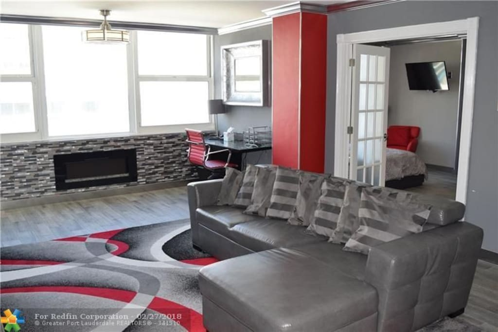 Renovated living room with cable TV
