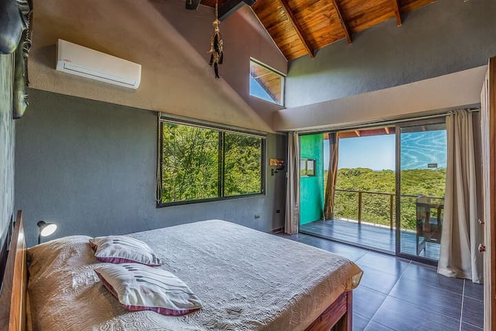 Master bedroom has a beautiful view of the Pacific Ocean. Awake each morning feeling invigorated by the beautiful sunrise, and enjoy unforgettable sunsets from the bedroom or deck.