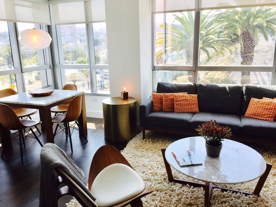 Dining and living room with views of Dolores blvd and Duboce Triangle; Italian-designed kitchen.