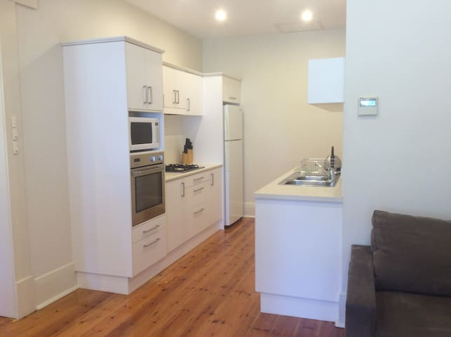 Fully equipped kitchen (including stainless steel wall oven and gas  hotplates, fridge & freezer, microwave, toaster & kettle).