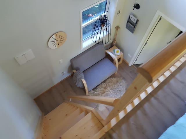 View of lounge and ladder from loft.