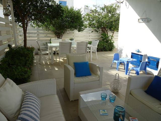 Private outdoor yard with furniture and barbeque