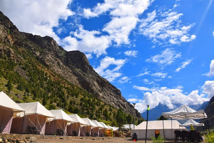 The camp is surrounded by rare herbs,unique trees & it offers you 360° view.From your own camp balcony or lazing under canopy in the campground,you can have mesmerizing view over viewing  snow clad mountains,river Bhaga,glaciers, beautiful meadows.