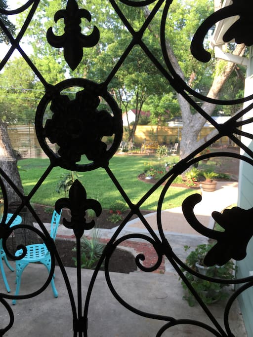 Lovely iron touch gives a glimpse of the backyard oasis