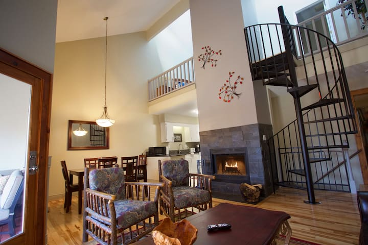 Main living area leads to screened in porch and balcony!