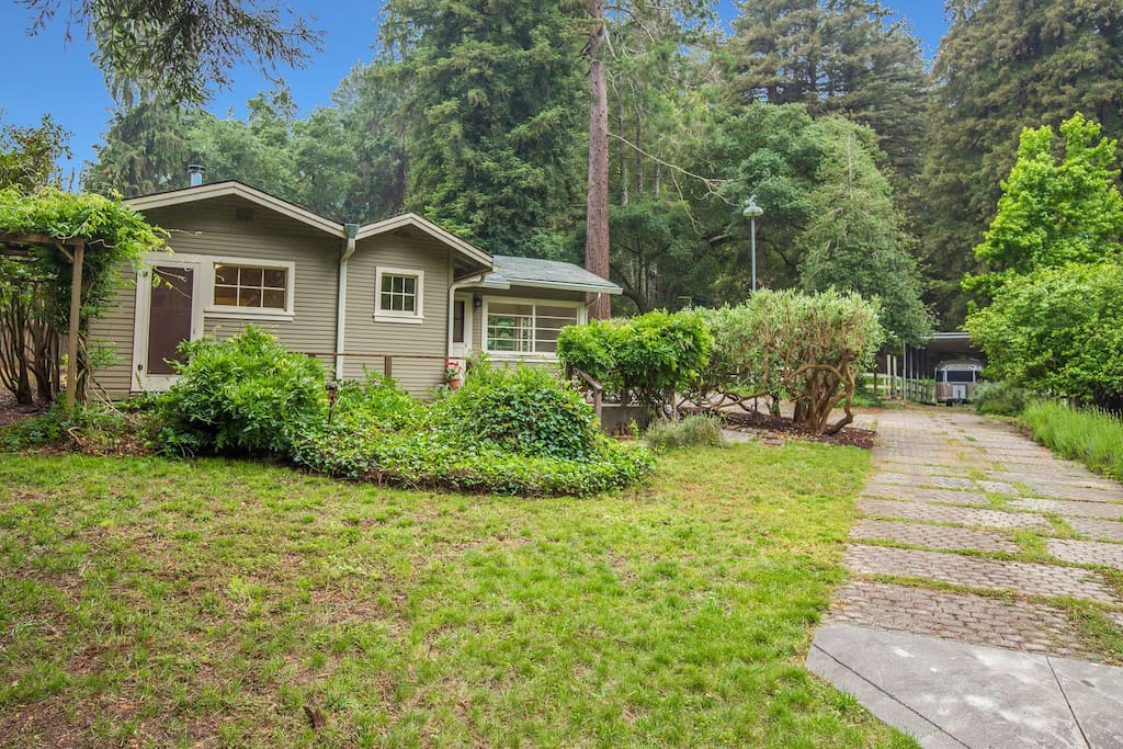 The cottage sits centrally on three acres, with the property itself  conveniently located across the street from Henry Cowell Redwoods State Park.