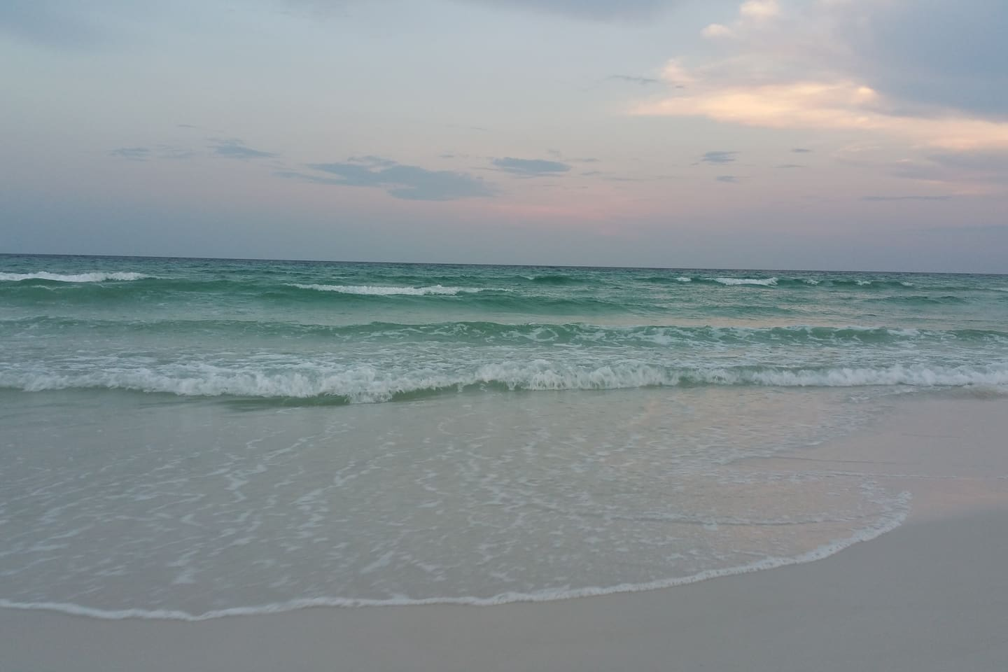 Sunset on Destin sugar-sand coast. Our home is 0.6 of a mile to the sand of the beautiful Emerald coast.