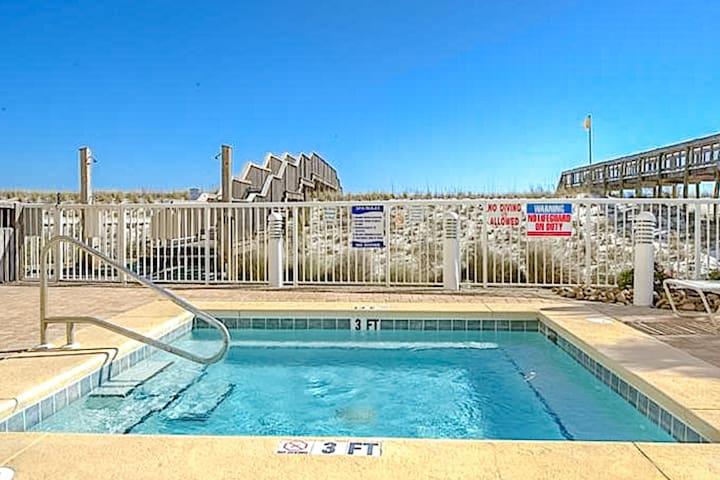 Beautiful beachfront condo w/ balcony, shared pool, and beach access!