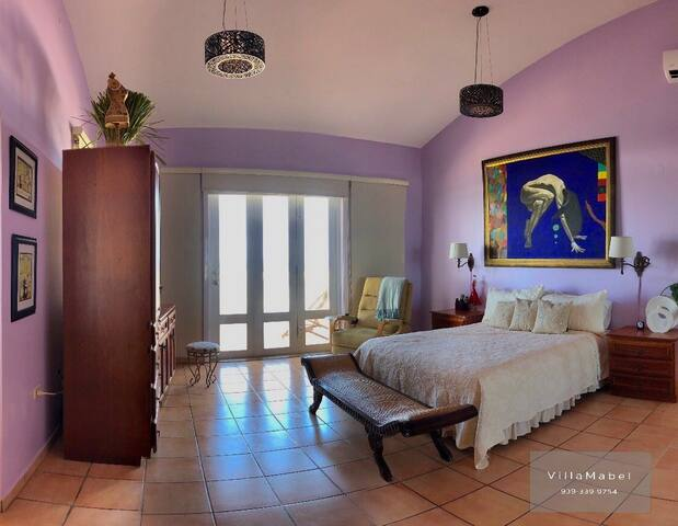This Master Bedroom has the other amazing view from the private balcony.  Chances are you will agree.