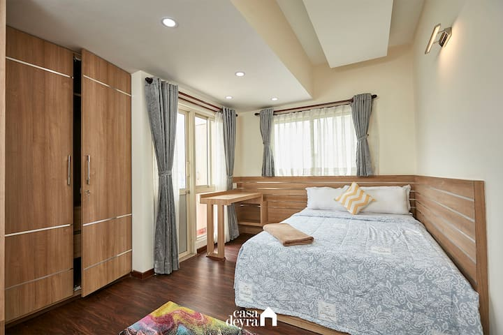 This bright and spacious bedroom with study table and a private balcony is what you need for stress relief.