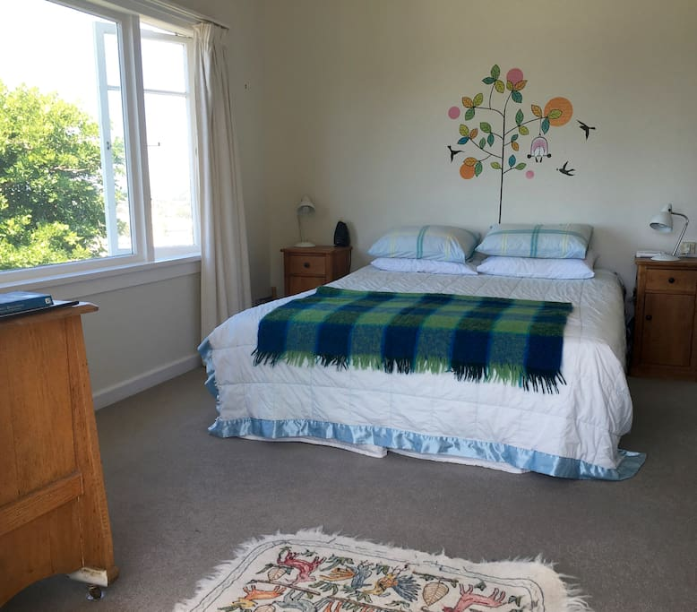 The spacious bedroom with comfy King bed