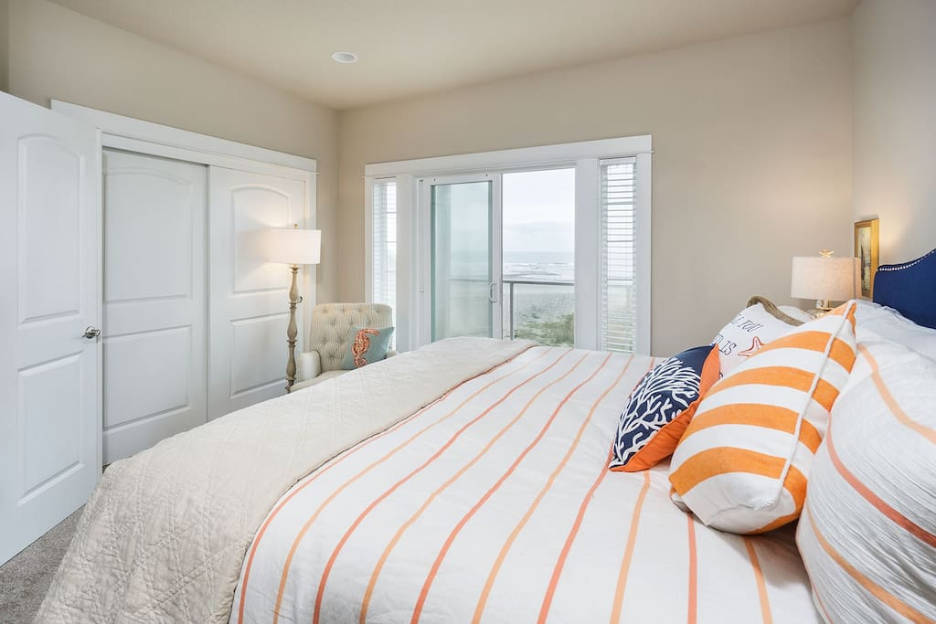 Master suite with balcony is perfectly situated to capture the ocean view and bring the outdoors inside