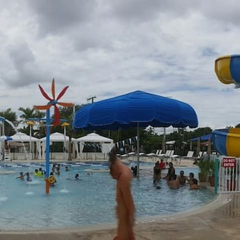 Community pool with children's pool and slides a mile away from the house