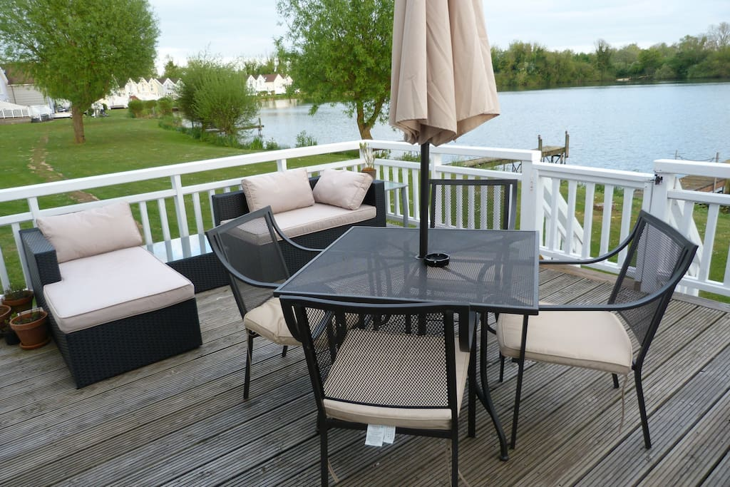 Sit back and relax with a drink on the lovely decking which overlooks the lake - we have a BBQ you are welcome to use and there is a grass area for children to play on