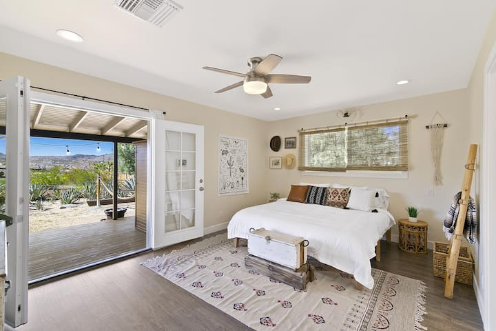 Our gorgeous master bedroom has double french doors that open out to the wraparound deck
