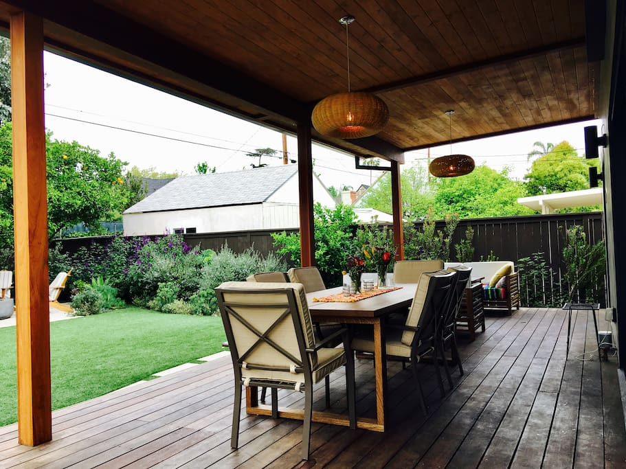 Back deck off the kitchen.  Dining for 6-8 people with deck overhang and lighting