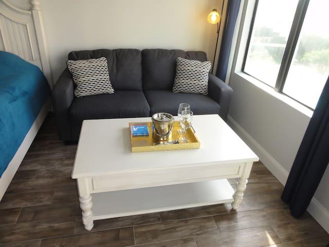 New sofa, coffee table & wine accessories.