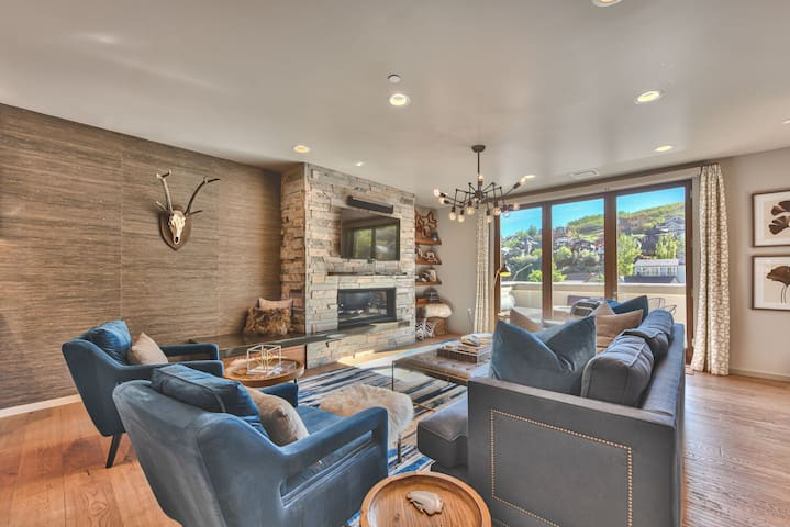 "Comfortable Contemporary Furnishings Surrounding a Stone Gas Fireplace, 55"" Smart TV, and a Private Deck with Old Town Views"