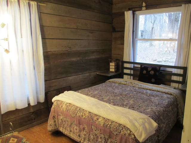 """The """"lavender room"""" with full bed."""