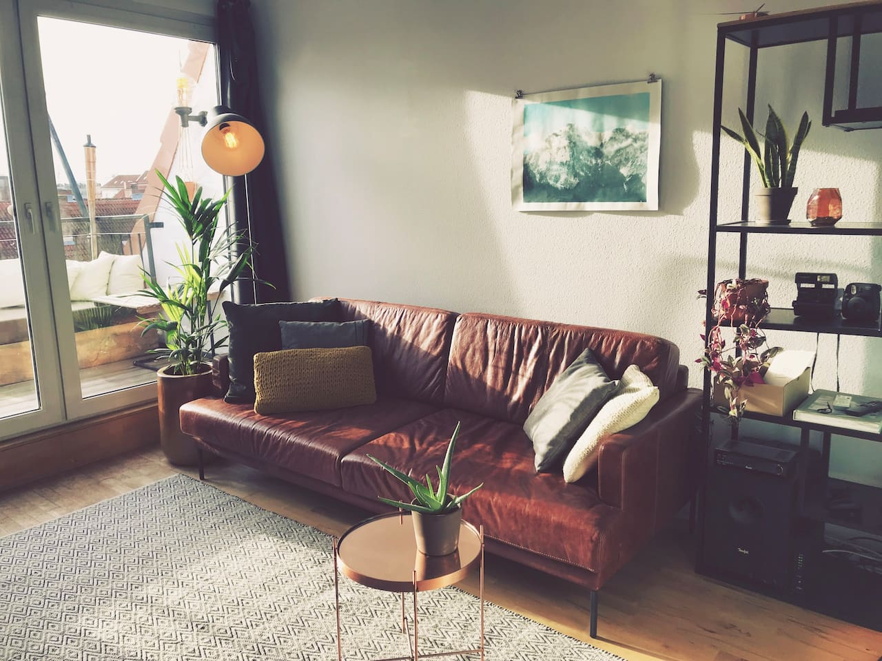 Sunny Living Room with Southside Balcony