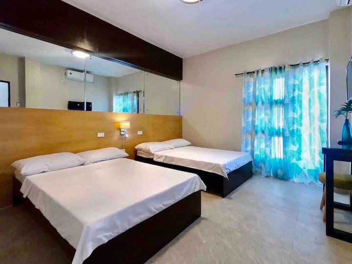 Rold & Roub Home Suites  Classic Quad Room