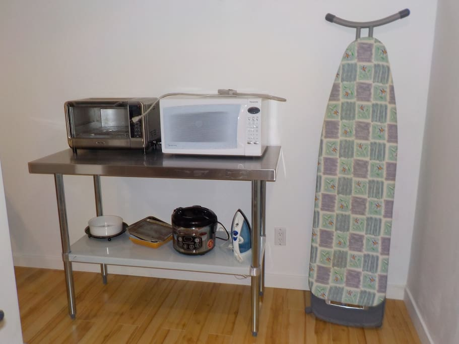 Cooking appliances e.g. convection toaster oven, microwave, rice cooker. Also iron and ironing board