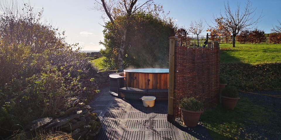 New all weather hot tub has views across the Cambrian mountains to the back and the lake and distant hills to the front. The ideal spot to enjoy star gazing and the Milky Way at night. Weather dependent.